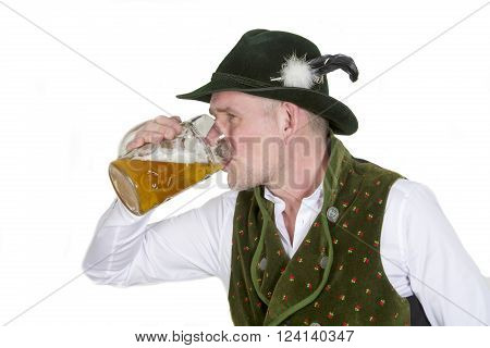 bavarian man in traditional bavarian clothes drinking beer