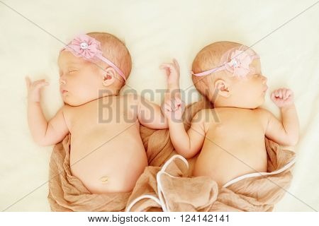 lovely newborn two twins girl are sleeping