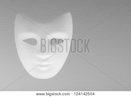 white mask texturized on a white paper