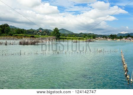 Fish Farm And Hatchery On Poso River Near Tentena. Indonesia
