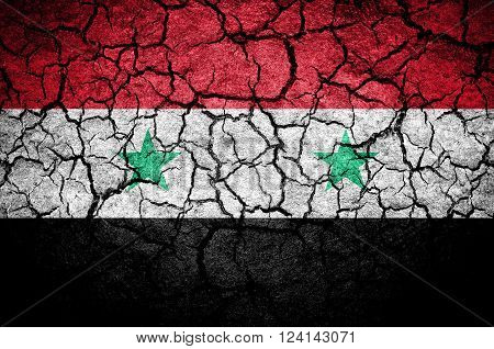 Syrian flag on a cracked background. dark colors