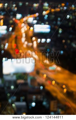 Aerial view blurred bokeh light city highway, night background