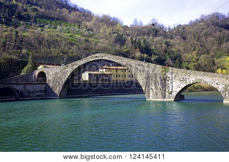 Magdalene bridge (also named Devil's bridge) over Serchio river in Tuscany Italy