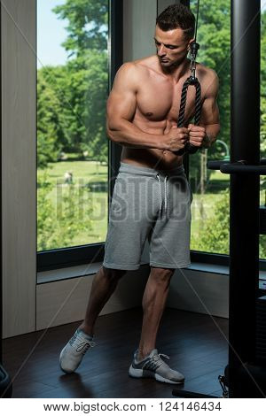 Man Doing Heavy Weight Exercise For Triceps