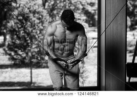 Bodybuilder Doing Exercise For Chest On Machine
