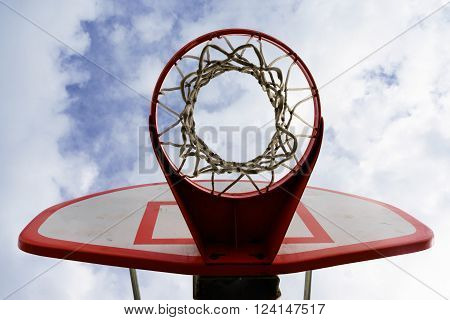 White Basketball Backboard with Blue Sky at a Basketball Court by Pacific Ocean