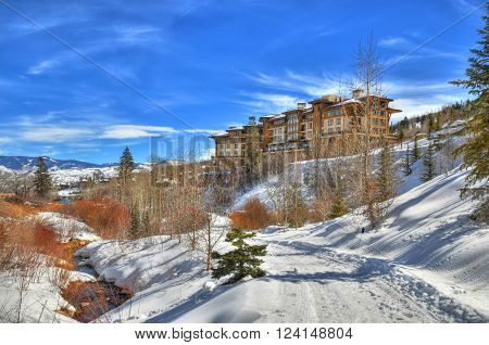 Beautiful colorful landscape in Snowmass - a river under a ski resort surrounded by trees (HDR image) in Aspen Colorado