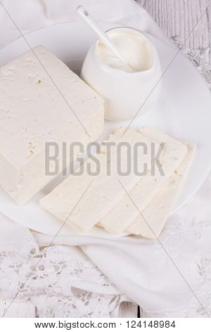 fresh sour cream and quark on a white table