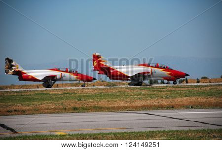 IZMIR/TURKEY-JUNE 5, 2011: Spanish Air Force's Aerobatic Display Team Patrulla Aguila's Casa C-101 Aircrafts at 2nd Main Jet Base Cigli for Airshow. June 5, 2011-Izmir/Turkey