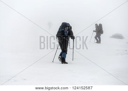 Mountain Hiking Group In Snow Storm