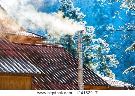 Smoke From The Chimney On The Roof