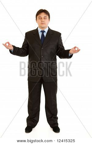 Meditating modern business woman isolated on white