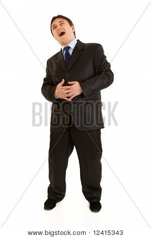 Full length portrait of laughing young businessman isolated on white