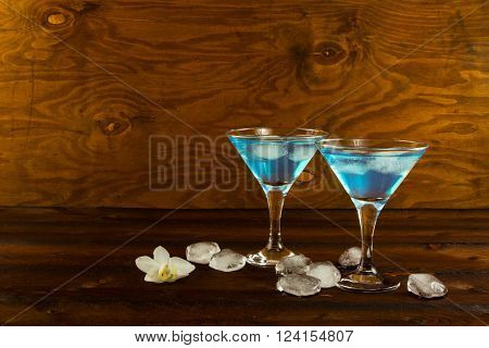 Blue curacao liqueur cocktail in a martini glasses. Blue cocktail. Blue margarita. Blue Hawaiian cocktail. Blue curacao liqueur. Blue Martini