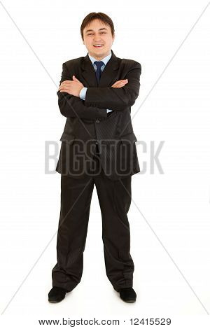 Smiling elegant businessman with crossed arms on chest isolated on white