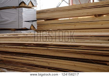 Woodworking. Image of wooden boards piled at sawmill