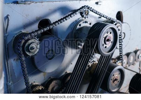 Close-up of chain stretched over gears on machine ** Note: Visible grain at 100%, best at smaller sizes