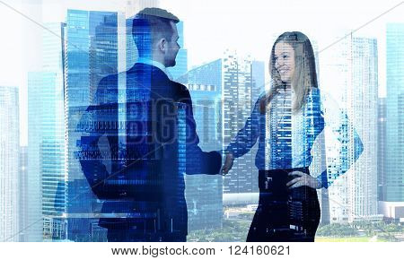 Businessman and businesswoman shaking hands, office building. Double exposure. Concept of work.