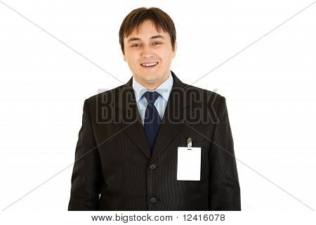 Elegant businessman with blank id card on his jacket isolated on white