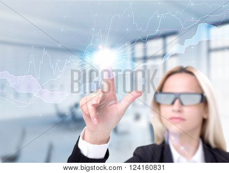 Businesswoman in 3D glasses touching graphs on virtual screen. Office background. Concept of virtual reality.