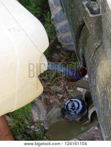 Refueling cars with fuel of plastic cans