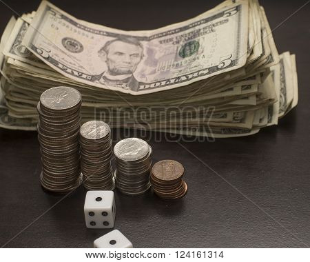 Assortment of cash coin and dice for gambling purposes