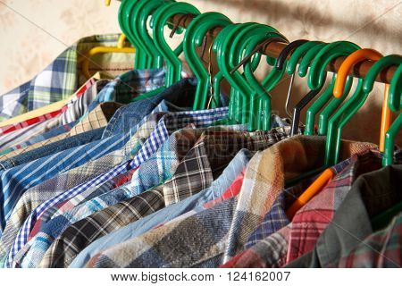 Variety of men's colorful shirts on Hangers