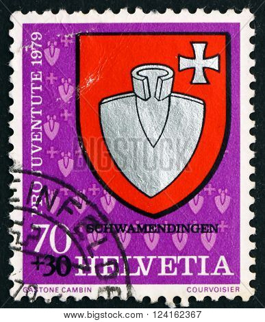 SWITZERLAND - CIRCA 1979: a stamp printed in the Switzerland shows Schwamendingen Communal Arms circa 1979