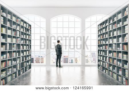 Library interior design with massive bookshelves and businessman. 3D Rendering