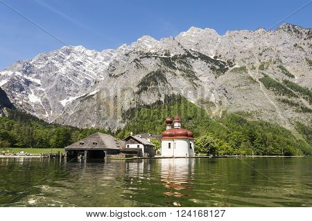 BERCHTESGADENGERMAN-MAY 11,2015:view of St. Bartholomew's Church Berchtesgaden in Bavarian Alps during a sunny day.