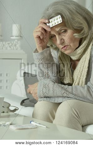 Portrait of senior woman feel unwell at home