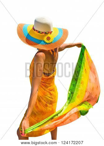 Rear view of attractive woman with yellow sarong and wide-brimmed hat.  Isolated on white background.