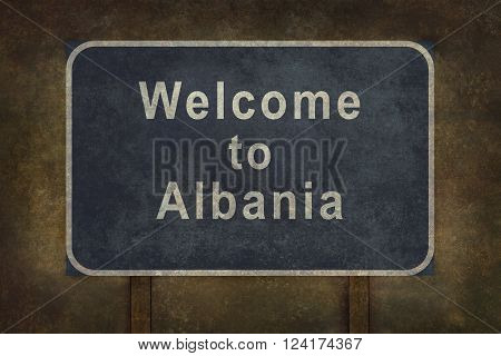 Distressed welcome to Albania road sign illustration with ominous background
