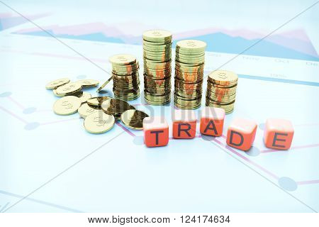 Golden dollar coin bars with trade dice on blurry chart background. 3D Rendering