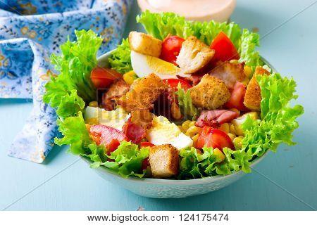 Cobb Salad with sauce . selective focus