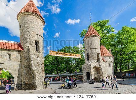 TALLINN ESTONIA - MAY 31: People walk down the street in the Old Town Celebration Days On May 31 2015 In Tallinn.