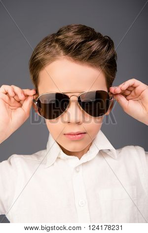 Close Up Portrait Of Little Serious Cool Boy In Glasses