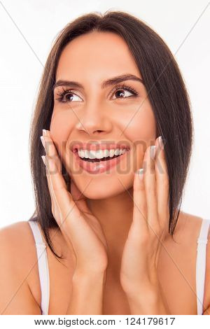 Portrait Of Beautiful Cheerful Woman Touching Her Face And Smiling