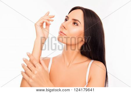 Sensitive Minded Young Girl Touching Hand On White Background