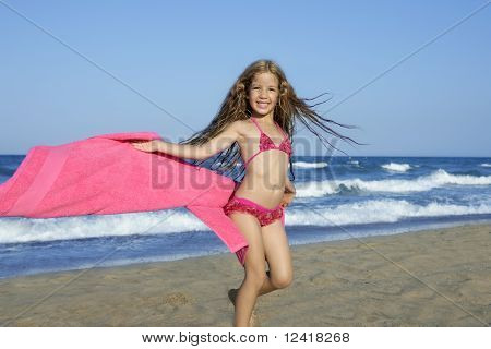 Beach Little Girl Playing Pink Towel And Wind