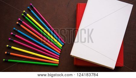 Wooden Desktop With Colorful Pencil And Book