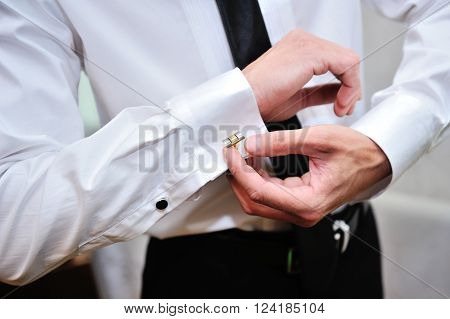 man wear a shirt and cufflinks for wedding day