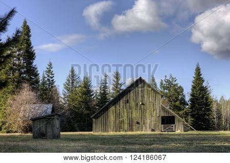 Old barn and shed. An old barn on a clear day in Hayden Idaho.