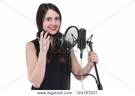 Brunette woman in headphones, recording of vocal on white background