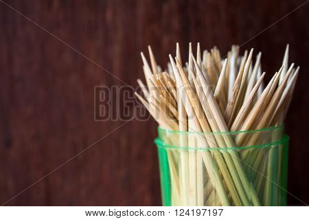 Wooden toothpicks on wood background isolate .