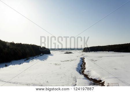 white snow lying on the ground in winter