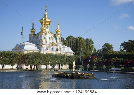 ST. PETERSBURG, RUSSIA - SEPTEMBER 20, 2015: The Church of the Holy apostles Peter and Paul, and a fountain Nymph