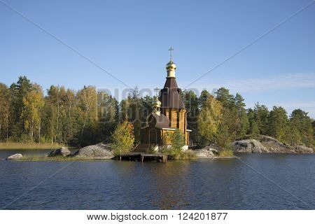 The Church of St. Andrew in the middle of the river Vuoksa autumn day. Priozersky district, Leningrad region, Russia