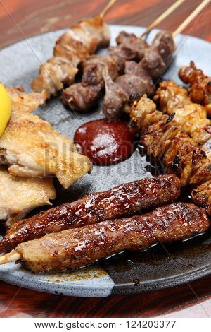 Japanese style chicken barbecue YAKITORI  on a dinibg table