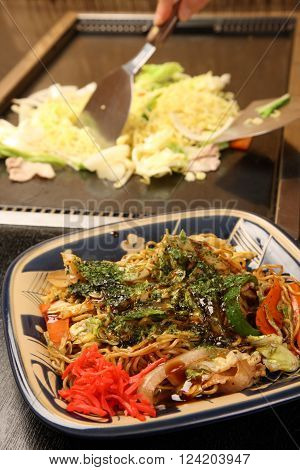 cooking traditional Japanese style fried noodles YAKISOBA